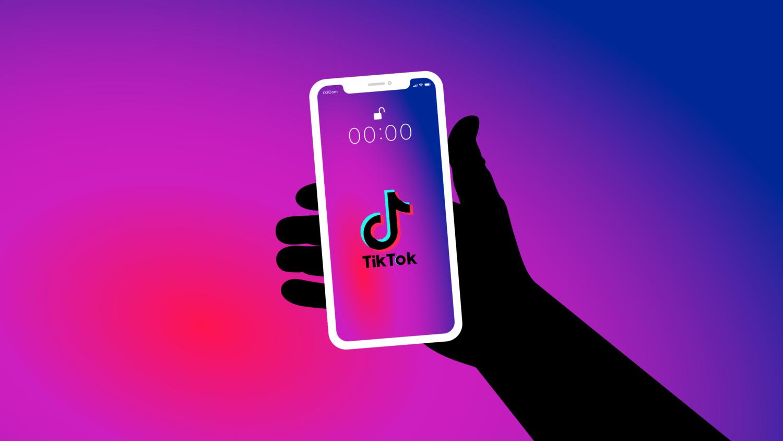 Gratis Download von iXimus.de: Symbolbild TikTok App, Smartphone weiß, iPhone, weiß, schwarze Hand, #000291-4
