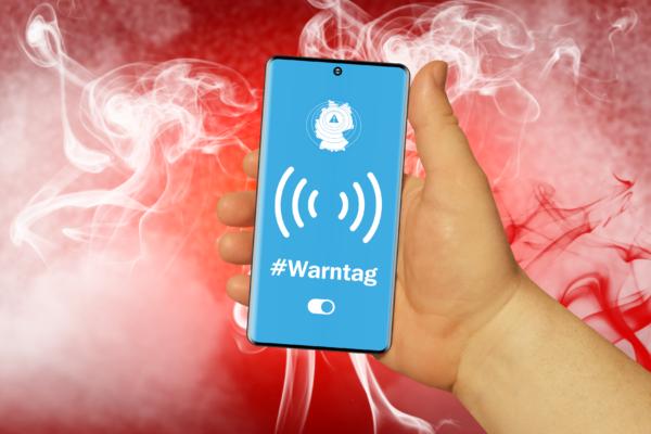 Download von iXimus.de: Warntag Warn-App, Hand mit Mobiltelefon, Feuer, #000440